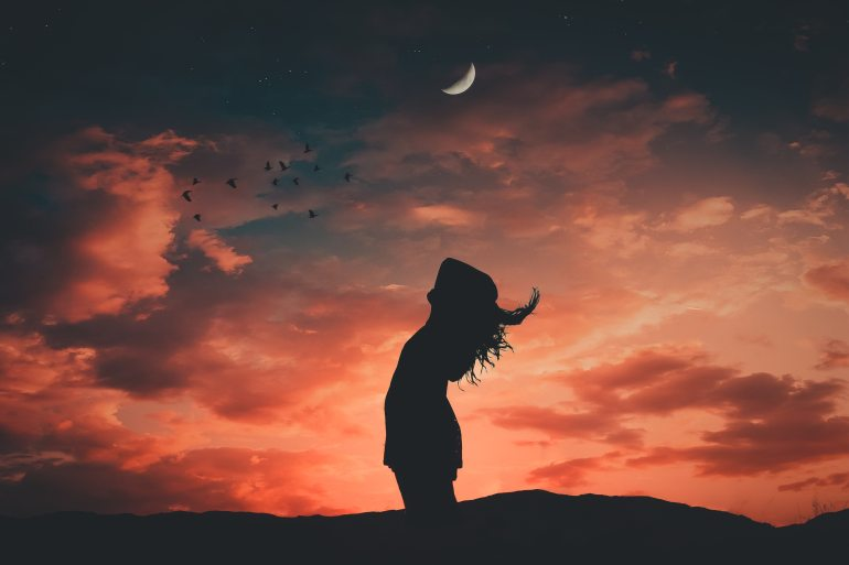 silhouette-photo-of-woman-during-dawn-1835016